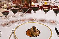 Dinner in the George V luxury restaurant in Paris. Boudin blanc white blood sausage. Paris, France. Wine tasting. Wine glasses.