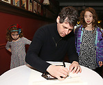 James Barbour with daughters attend his Top Secret portrait unveiling at Sardi's on March 10, 2017 in New York City.