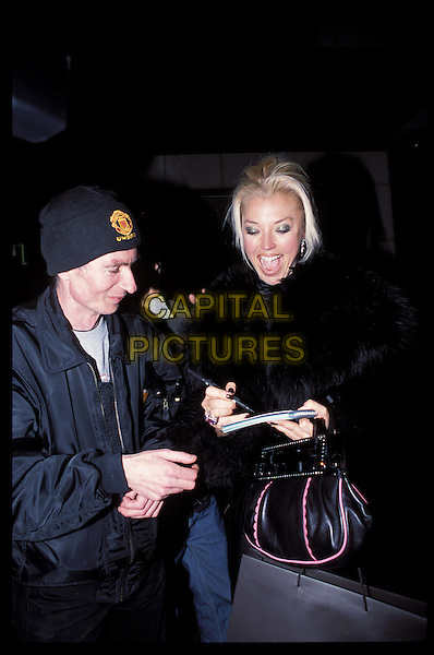 TAMARA BECKWITH.signing autograph, laughing, moiuth open, half length,half-length, fan.RAW SCAN - PHOTO WILL BE ADJUSTED FOR PUBLICATION.www.capitalpictures.com.sales@capitalpictures.com.©Capital Pictures.