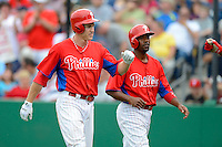 Philadelphia Phillies second baseman Chase Utley #26 and Jimmy Rollins #11 greeted at the dugout after Utley hit a two run home run during a Spring Training game against the Boston Red Sox at Bright House Field on March 24, 2013 in Clearwater, Florida.  Boston defeated Philadelphia 7-6.  (Mike Janes/Four Seam Images)