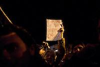 Roma, 12 Novembre 2011.Una donna mostra il suo cartello durante la manifestazione spontanea davanti al Quirinale per festeggiare le dimissioni di Silvio berlusconi da Presidente del Consiglio