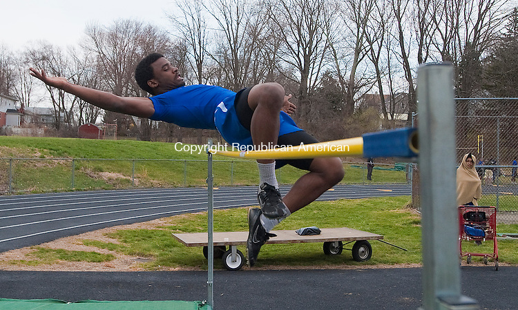 WATERBURY, CT-0419014JS07-Crosby's Dayshawn Smith clears 5' 6&quot; in the high jump during their meet with Kennedy, Holy Cross and Watertown Tuesday at Holy Cross High School in Waterbury.<br /> Jim Shannon Republican-American