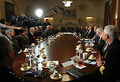 Washington, D.C. - January 24, 2007 -- United States President George W. Bush makes a statement to the press during a meeting with military leaders in the Cabinet Room of the White House on January 24, 2007. .Credit: Roger L. Wollenberg - Pool via CNP