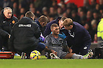 Kieran Trippier of Burnley receives attention after a knock to the head - Manchester United vs. Burnley - Barclay's Premier League - Old Trafford - Manchester - 11/02/2015 Pic Philip Oldham/Sportimage