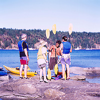 Kayakers taking Kayaking Lesson at Tribune Bay Provincial Park, on Hornby Island, in the Northern Gulf Islands, British Columbia, Canada