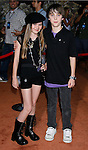 Actress Madeline Carroll and Actor Sterling Bowman arrive at the Disney-Pixar's WALL-E Premiere on June 21, 2008 at Greek Theatre in Los Angeles, California.