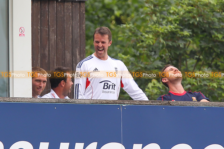 Graeme Swann of England (C) shares a joke with Mark Pettini of Essex (L) and Shaun Tait after leaving the field with an arm injury - Essex CCC vs England - LV Challenge Match at the Essex County Ground, Chelmsford - 01/07/13 - MANDATORY CREDIT: Gavin Ellis/TGSPHOTO - Self billing applies where appropriate - 0845 094 6026 - contact@tgsphoto.co.uk - NO UNPAID USE