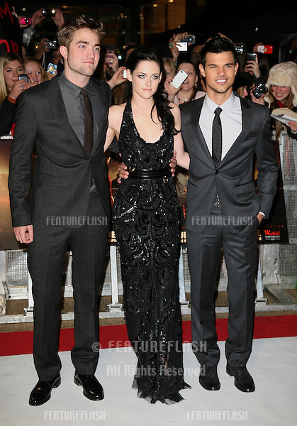 Robert Pattinson, Kristen Stewart and Taylor Lautner arriving for the UK premiere of The Twilight Saga: Breaking Dawn Part 1 at Westfield Stratford City, London. 17/11/2011 Picture by: Alexandra Glen / Featureflash