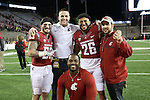 Kaleb Fossum (83), Jack Taylor, Hunter Dale (26), Eric Mele and Antonio Huffman pose for a photo following the Washington State Cougars destruction of the Cal Bears, 56-21, on November 12, 2016, at Martin Stadium in Pullman, Washington.