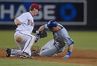 Jun 27, 2007; Phoenix, AZ, USA; Arizona Diamondbacks shortstop (6) Stephen Drew tags out Los Angeles Dodgers outfielder (26) Luis Gonzalez at Chase Field. Mandatory Credit: Mark J. Rebilas