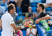 Julien Benneteau of France congratulates Grigor Dimitrov of Bulgaria on Day 03 of the Aegon Championships, Queen's Club, London, UK, 21 Jun 2017