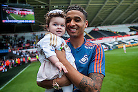 Kyle Naughton on the pitch with team players and staff during a lap of honour after the Barclays Premier League match between Swansea City and Manchester City played at the Liberty Stadium, Swansea on the 15th of May  2016