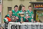 SILVERWARE: Members of Milltown-Castlemaine GAA Club show their silverware at the Milltown St Patricks Day Parade on Saturday..
