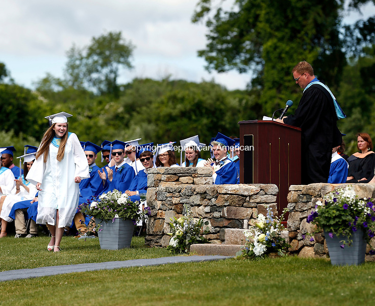 Washington, CT- 13 June 2015-061315CM06-  Shepaug Valley High School faculty member Todd Dyer, right, recognizes Rachel Crossley, shown at left, as the recipient of the Academic Commitment Award,  during commencement exercises at the high school on Saturday.   Christopher Massa Republican-American