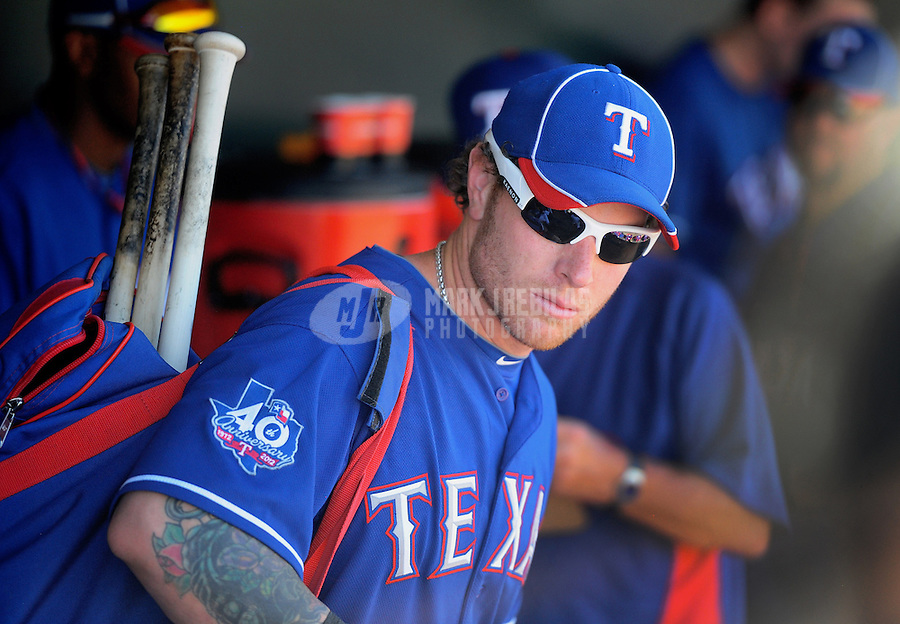Mar. 15, 2012; Surprise, AZ, USA; Texas Rangers outfielder Josh Hamilton in the dugout in the fifth inning against the Oakland Athletics at Surprise Stadium.  Mandatory Credit: Mark J. Rebilas-