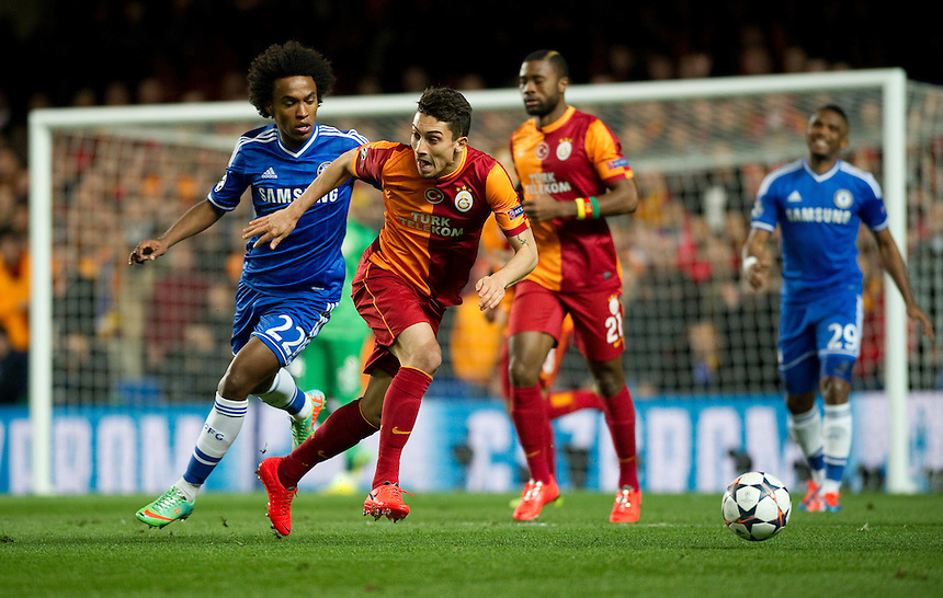 Galatasaray's Alex Telles holds off the challenge from Chelsea's Willian<br /> <br /> Photo by Ashley Western/CameraSport<br /> <br /> Football - UEFA Champions League First Knockout Round 2nd Leg - Chelsea v Galatasaray - Tuesday 18th March 2014 - Stamford Bridge - London<br />  <br /> &copy; CameraSport - 43 Linden Ave. Countesthorpe. Leicester. England. LE8 5PG - Tel: +44 (0) 116 277 4147 - admin@camerasport.com - www.camerasport.com