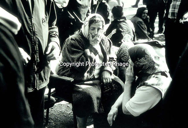 Kosovar refugee woman on April 24, 1998 in refugee camp in Stankovic outside Skopje, Macedonia. Hundreds of thousands of people fled Serb terror intoAlbania and Macedonia. These families waited to board a bus to Skopje airport and be flewn to a European host country; old women wearing scarves; refugees..©Per-Anders Pettersson/iAfrika Photos