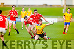 Feale Rangers Barry O'Mahony tries to hold possession despite been under pressure from Chris O'Donoghue and Sean O'Leary of East Kerry in the County U21 Football Final in Austin Stack Park on Thursday.