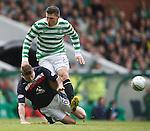 Iain Davidson takes out Celtic's Gary Hooper.