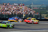 6-8 August, 2010, Watkins Glen, New York USA.Marcos Ambrose (#47) passes Kurt Busch (#2) for second..©2010 F.Peirce Williams, USA.