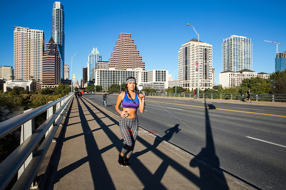 From the obvious running choices to the secret gems awaiting your footfalls, Austin's running terrain is as broad as the Lone Star State. The Congress Avenue Bridge is a popular and favorite scenic view on the Lady Bird Lake Hike-and-Bike Trail - stock image.