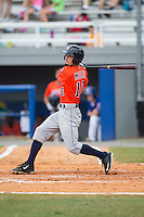 Aaron Mizell (10) of the Greeneville Astros follows through on his swing against the Kingsport Mets at Hunter Wright Stadium on July 7, 2015 in Kingsport, Tennessee.  The Mets defeated the Astros 6-4. (Brian Westerholt/Four Seam Images)