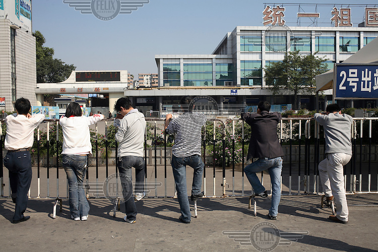 Migrant workers returning to their rural homes outside of the train station in Guangzhou.