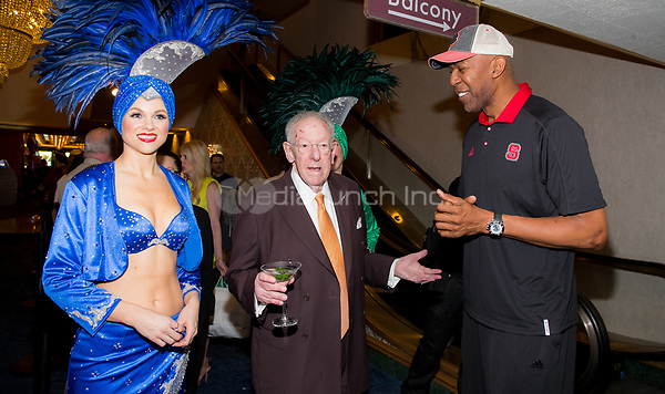 LAS VEGAS, NV - March 16, 2017: ***HOUSE COVERAGE*** Former Las Vegas Mayor and Host Committee Chairman Oscar B. Goodman and Former NBA Player Thurl Bailey pictured with showgirls at Hoops Central Basketball viewing event at Westgate Las Vegas Resort & Casino in Las vegas, NV on March 16, 2017. Credit: Erik Kabik Photography/ MediaPunch