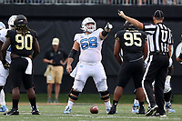 WINSTON-SALEM, NC - SEPTEMBER 13: Brian Anderson #68 of the University of North Carolina points to his blocking assignment during a game between University of North Carolina and Wake Forest University at BB