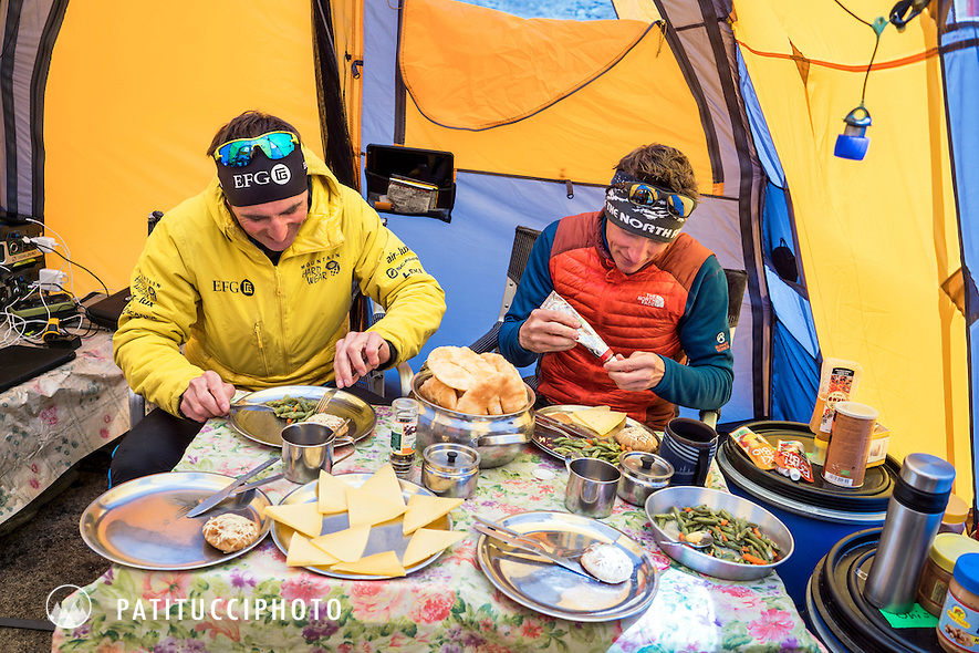 Ueli Steck and David Göttler inside their basecamp tent getting ready to eat during their climbing expedition to the 8000 meter peak Shishapangma, Tibet