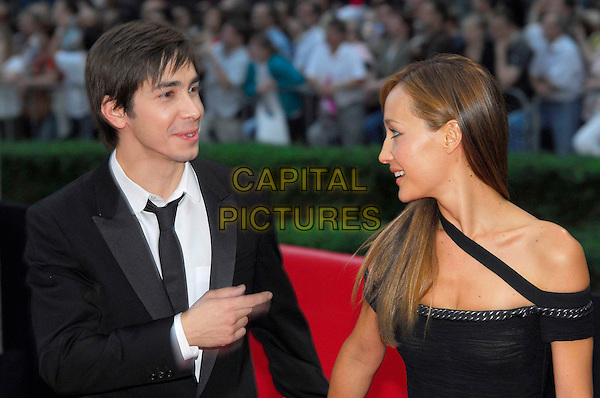 "JUSTIN LONG & MAGGIE Q.Attends the German Premiere of ""Die Hard 4.0"" at the Cinestar Sony Center in Berlin, Germany, .June 18th 2007..half length.CAP/PPG.©Norbert Kesten/People Picture/Capital Pictures. *** Local Caption *** 00315703"