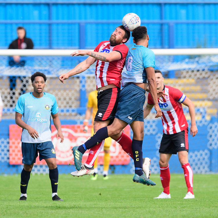 Lincoln City's Michael Bostwick vies for possession with Gainsborough Trinity's Shane Clarke<br /> <br /> Photographer Chris Vaughan/CameraSport<br /> <br /> Football Pre-Season Friendly (Community Festival of Lincolnshire) - Gainsborough Trinity v Lincoln City - Saturday 6th July 2019 - The Martin & Co Arena - Gainsborough<br /> <br /> World Copyright © 2018 CameraSport. All rights reserved. 43 Linden Ave. Countesthorpe. Leicester. England. LE8 5PG - Tel: +44 (0) 116 277 4147 - admin@camerasport.com - www.camerasport.com