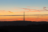 """Emley Moor transmitting station as seen from Castle Hill, Huddersfield, is a telecommunications and broadcasting facility on Emley Moor in Kirklees, West Yorkshire, England. <br /> A 1,084-foot-tall (330.4 m) concrete tower and apparatus which began transmitting in 1971. It is protected under UK law as a Grade II listed building. It is the tallest freestanding structure in the United Kingdom, seventh-tallest freestanding structure and fourth-tallest tower in Europe outside Russia, and 24th-tallest tower in the world.<br /> <br /> The tower's current official name, Arqiva Tower, is shown on a sign beside the offices at the base of the tower, but it is commonly known as """"Emley Moor mast""""."""