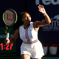 MIAMI GARDENS, FLORIDA - MARCH 22: Serena Williams of the United States Squinting into the late afternoon sun, tried to shield her eyes from the bright light  as she defeats Rebecca Peterson of Sweden on Day 5 of the Miami Open Presented by Itau at Hard Rock Stadium on March 22, 2019 in Miami Gardens, Florida<br /> <br /> People: Serena Williams
