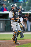 West Virginia Power catcher Reese McGuire (24) looks to the dugout for a sign during the game against the Kannapolis Intimidators at CMC-Northeast Stadium on April 17, 2014 in Kannapolis, North Carolina.  The Power defeated the Intimidators 4-3.  (Brian Westerholt/Four Seam Images)