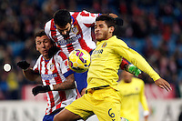 Mario Mandzukic and Arda Turan of Atletico de Madrid and Jonathan Dos Santos of Villarreal during La Liga match between Atletico de Madrid and Villarreal at Vicente Calderon stadium in Madrid, Spain. December 14, 2014. (ALTERPHOTOS/Caro Marin) /NortePhoto