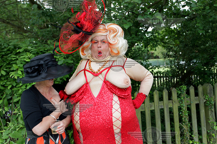 A man wears a novelty costume during the Royal Ascot race meeting. The annual event, during which each day begins with the Queen's arrival in a horse drawn carriage, dates back to 1711 when Queen Anne organised the first races on what was then a heath near Windsor Castle.
