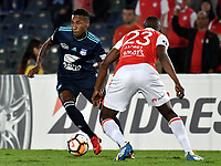 BOGOTA - COLOMBIA - 01 - 03 - 2018: Javier Lopez (Der.) jugador de Independiente Santa Fe disputa el balón con Eduar Preciado (Izq.) jugador de Emelec (ECU), durante partido entre Independiente Santa Fe (COL) y Emelec (ECU), de la fase de grupos, grupo 4, fecha 1 de la Copa Conmebol Libertadores 2018, jugado en el estadio Nemesio Camacho El Campin de la ciudad de Bogota. / Javier Lopez (R) player of Independiente Santa Fe vies for the ball with Eduar Preciado (L) player of Emelec (ECU), during a match between Independiente Santa Fe (COL) and Emelec (ECU), of the group stage, group 4, 1st date for the Conmebol Copa Libertadores 2018 at the Nemesio Camacho El Campin Stadium in Bogota city. Photo: VizzorImage  / Luis Ramirez / Staff.