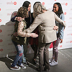 Renee Ehrlich Kalfus hugs Cast of Annie at the Annie For Target collection celebration and pop-up shop at Stage 37 in New York City on November 4, 2014.
