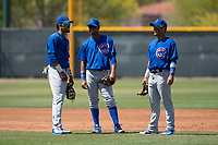 Chicago Cubs infielders Christopher Morel (16), Josue Huma (13), and Orian Nunez (18) talk through a pitching change during an Extended Spring Training game against the Colorado Rockies at Sloan Park on April 17, 2018 in Mesa, Arizona. (Zachary Lucy/Four Seam Images)