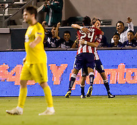 Chivas USA midfielder Blair Gavin (18) celebrates his goal with teammate Rodolfo Espinoza (24). CD Chivas USA defeated the Columbus Crew 3-1 at Home Depot Center stadium in Carson, California on Saturday July 31, 2010.