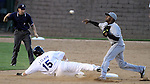 SIOUX FALLS, SD - MAY 17:  Leugim Barroso #5 from the Sioux City Explorers turns a double play as Jared Clark #15 from the Sioux Falls Canaries slides into second Friday night at the home opener at the Sioux Falls Stadium. (Photo by Dave Eggen/Inertia)