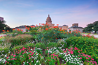 Flowers, roses, shrubs, and over 20 monuments decorate the 22 acres that makes up the Texas State Capitol grounds. The capitol itself rises 308 feet into the air, as seen here on a calm September morning. This photograph shows the north side of the historic landmark and faces south.