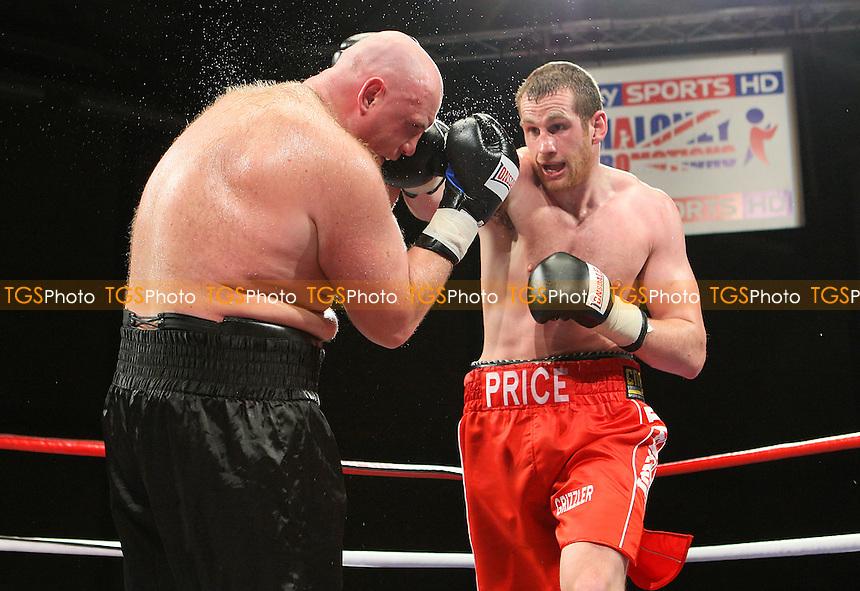 David Price (red shorts) defeats Daniil Peretyatko in a Heavyweight boxing contest at Goresbrook Leisure Centre, Dagenham, promoted by Frank Maloney - 14/05/10 - MANDATORY CREDIT: Gavin Ellis/TGSPHOTO - Self billing applies where appropriate - Tel: 0845 094 6026