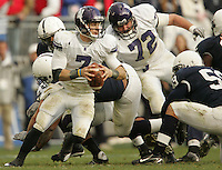 State College, PA - 11/06/2010:  Northwestern quarterback Dan Persa carries the ball.  Persa was 16 for 25 passing, for 201 yards and one touchdown.  He also was the Northwestern leading rusher, carrying the ball 25 times for 109 yards.  Despite trailing 21-0 in the first quarter, Penn State defeated Northwestern by a score of 35-21 at Beaver Stadium to give head coach Joe Paterno his 400th career victory...Photo:  Joe Rokita / JoeRokita.com..Photo ©2010 Joe Rokita Photography
