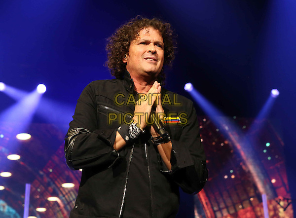 ATLANTA, GA- September 27: Carlos Vives performs on Sept. 27, 2015 at Philips Arena in Atlanta. <br /> CAP/MPI/COH<br /> &copy;COH/MPI/Capital Pictures