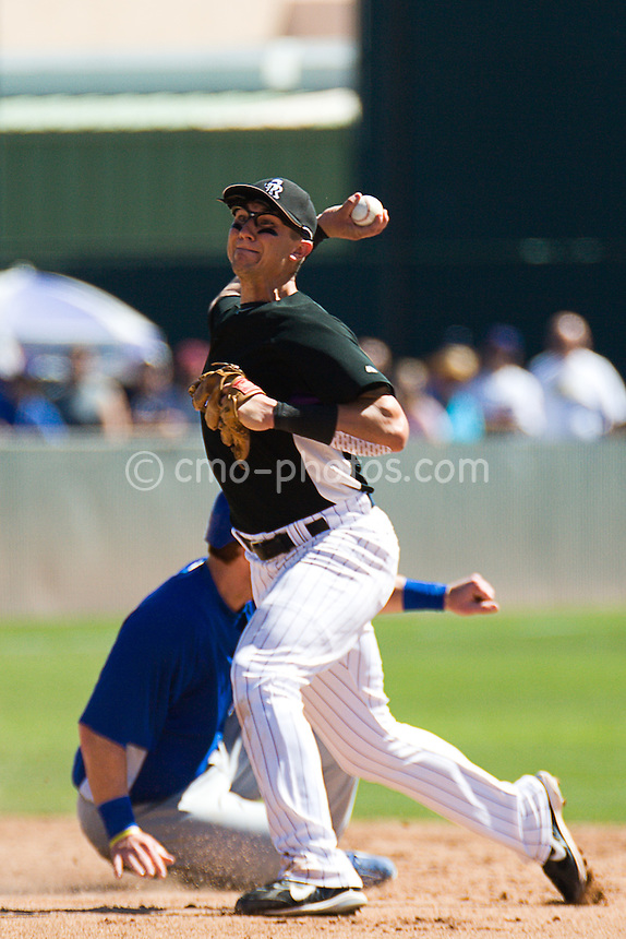 Mar 21, 2008; Tucson, AZ, USA;  Colorado Rockies shortstop Troy Tulowitzki (2) attempts to turn a double play during a game against the Chicago Cubs at Hi Corbett Field.