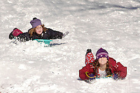 Anna Preston (L), 5, and Addie King, 7,  both of Doylestown, Pennsylvania enjoy a day of sledding after a winter snow storm closed schools December 9, 2005 in Doylestown, Pennsylvania. The Philadelphia region was hit with alomst 8 inches of snow, closing schools and some businesses. Photo by William Thomas Cain / photodx.com