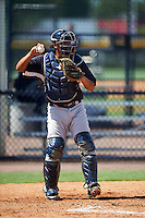 GCL Yankees West catcher Carlos Gallardo (55) warms up the pitcher in between innings during a game against the GCL Yankees East on August 3, 2016 at the Yankees Complex in Tampa, Florida.  GCL Yankees East defeated GCL Yankees West 12-2.  (Mike Janes/Four Seam Images)