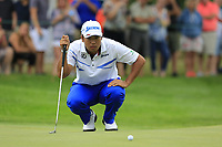 Hideki Matsuyama (JPN) lines up his birdie putt on the 17th green during Sunday's Final Round of the WGC Bridgestone Invitational 2017 held at Firestone Country Club, Akron, USA. 6th August 2017.<br /> Picture: Eoin Clarke | Golffile<br /> <br /> <br /> All photos usage must carry mandatory copyright credit (&copy; Golffile | Eoin Clarke)